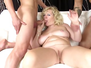 Mature mom suck and fuck two young boys