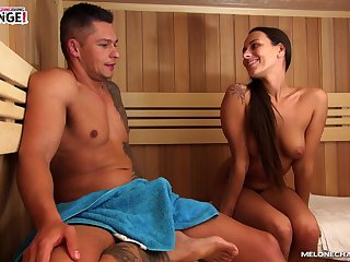 Sexy tanned nympho with juicy tits Mea Melone gives BJ in the sauna